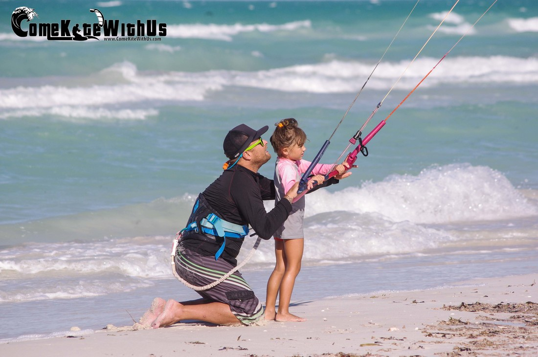 ComeKiteWithUs kiteboard kitesurf lessons El Cuyo Mexico family fun buoy wear